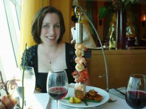 Sonja poses with a fancy dinner